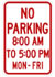 "A white street sign with red text that reads ""No parking 8 a.m. to 5 p.m. Monday through Friday."""