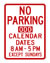 "A white street sign with red text that reads ""No parking odd calendar dates 8 a.m. to 5 p.m. except Sundays."""