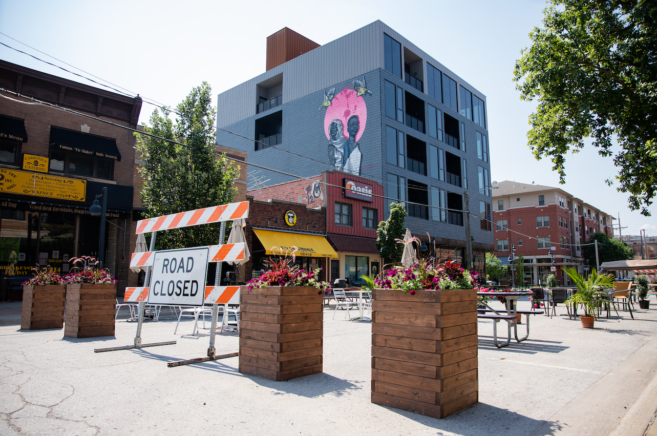 Outdoor seating space on North Linn Street is shown.