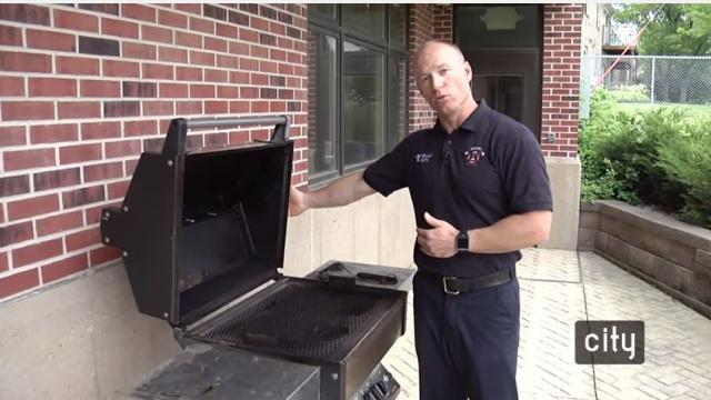 Firefighter Brandon Smith shares some safety tips while grilling.