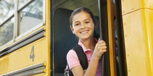 Image of child on school bus