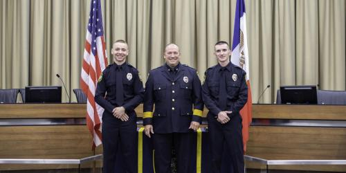 Two officers pose with the Iowa City Police Chief.