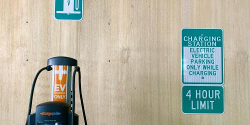 An electric vehicle charing station is shown in a Downtown Iowa City parking ramp.