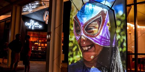 Public art featuring a luchadores mask is shown in Downtown Iowa City.