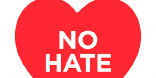 "A heart with the text ""no hate"" written in the middle."