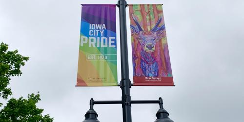 A LGBTQ Pride banner is shown in Iowa City.