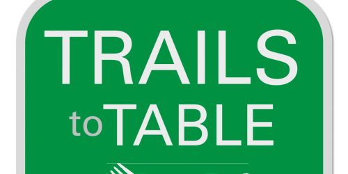A logo for the Trails to Table Charity event.