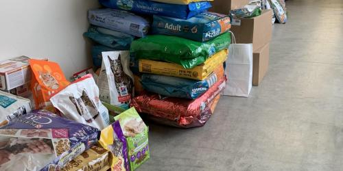 Donated pet food is shown at the Animal Care and Adoption Center.
