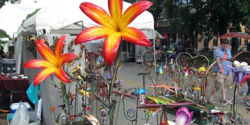 Colorful yard art on display at the Iowa Arts Festival. Photo by Alan Light. License: https://creativecommons.org/licenses/by/2.0/legalcode