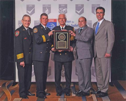 From left: Randy Bruegman, President, Center for Public Safety Excellence; John Grier, Fire Chief; Roger Jensen, Deputy Fire Chief; Clint McFarland, Local 610 President; Allan Cain, Chairman, Commission on Fire Accreditation International