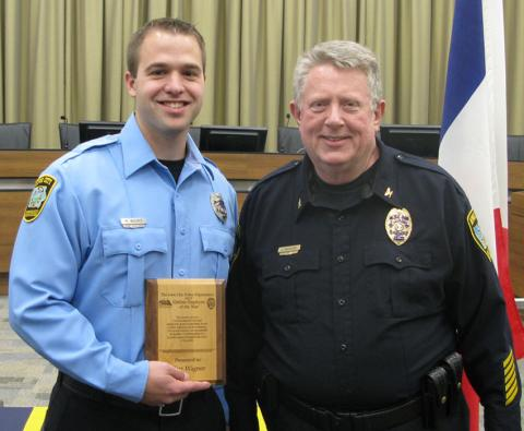 Matt Wagner receives the 2015 Iowa City Police Department Civilian Employee of the Year award from ICPD Chief Sam Hargadine.