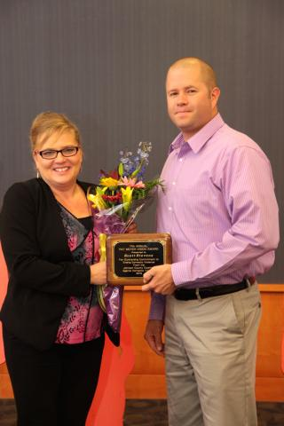 Iowa City Police Officer Scott Stevens received the Pat Meyer Vision Award from Joey Matousek, the 2014 award recipient.
