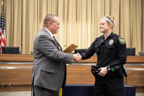 Police Chief Jody Matherly gives an award to Police Officer Ashley Jay.