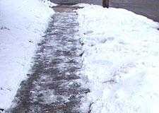 An appropriately cleared sidewalk after a snowfall.