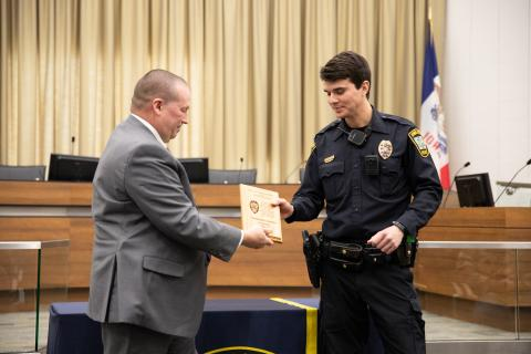 Iowa City Police Officer Zachary Murguia, winner of the Richard Lee Award, accepts the award from Police Chief Jody Matherly at a ceremony on Wednesday, Feb. 5, 2020.