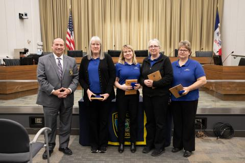 Kathy Droll, Rebecca Passavant, Sara Van Eck, and Lori Schroeder accept the Civilian Employee of the Year Award.