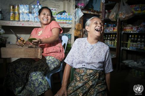 A seventy-year-old woman laughs with family members inside a grocery store in Tachilek, Myanmar.