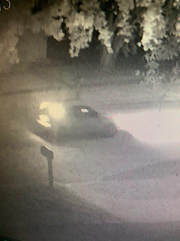 A car shown on surveillance tape at night.