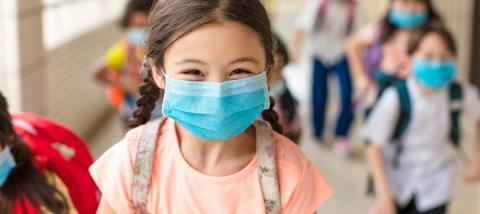 Elementary student wearing a face mask