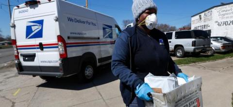 Mail carrier wearing a mask mask