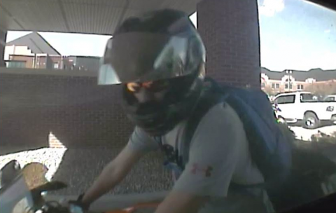 A photo of a suspect in a credit card fraud investigation.