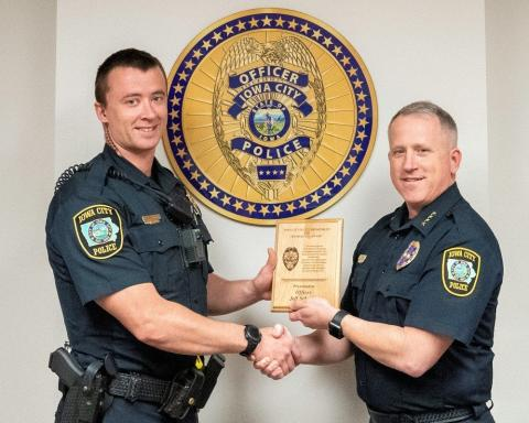 Officer Jeffrey Schmidt accepts award from Chief Dustin Liston.