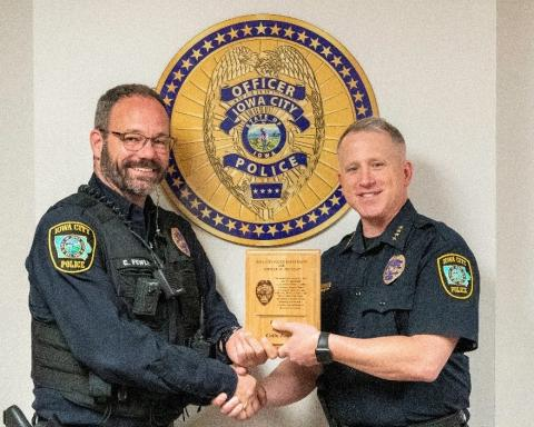 Officer Colin Fowler accepts award from Chief Dustin Liston.