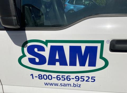 A logo for Surveying And Mapping (SAM), LLC.