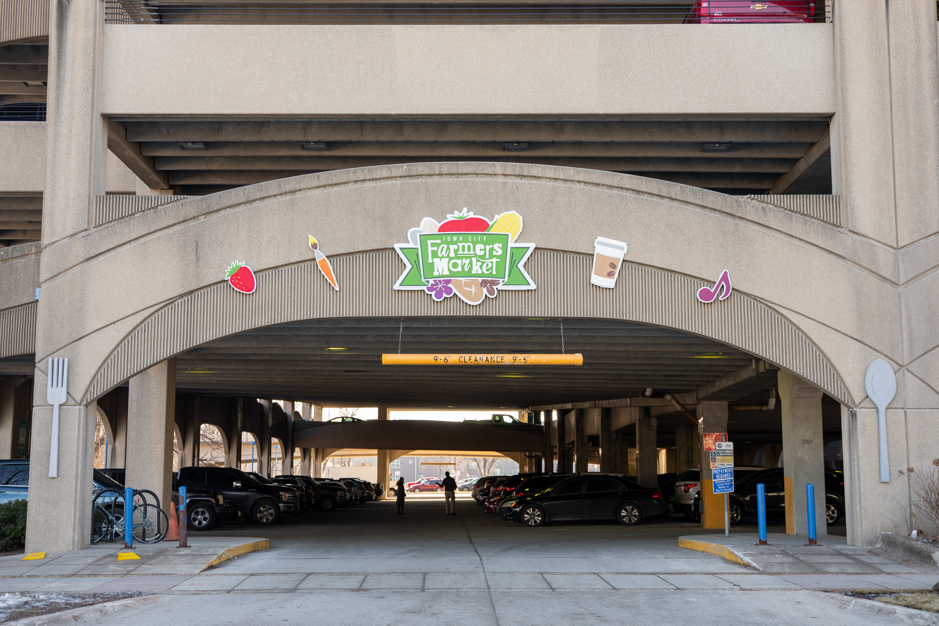 New artwork celebrating the Farmers Market at the Chauncey Swan Parking Ramp is shown.